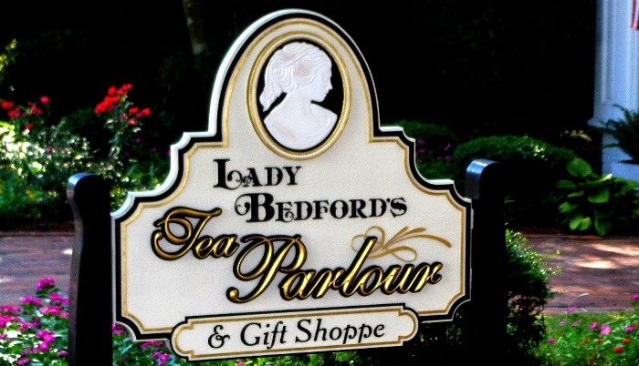 lady bedford hand carved bas relief with 23kt gold prismatic letters on sandblasted sign by classic signs nc700x440