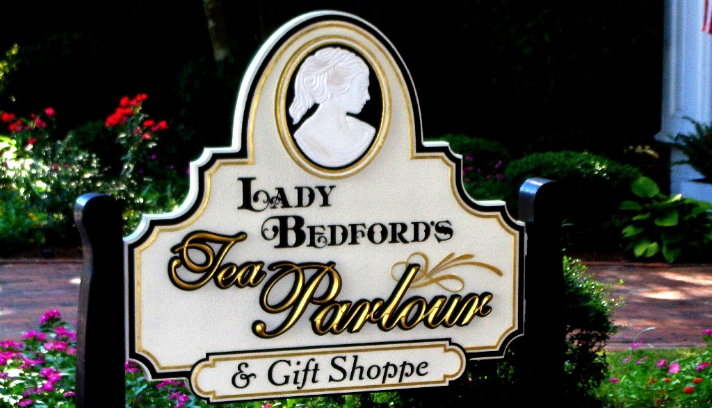 lady bedford hand carved bas relief with 23kt gold prismatic letters on sandblasted sign by classic signs nc 1024x588