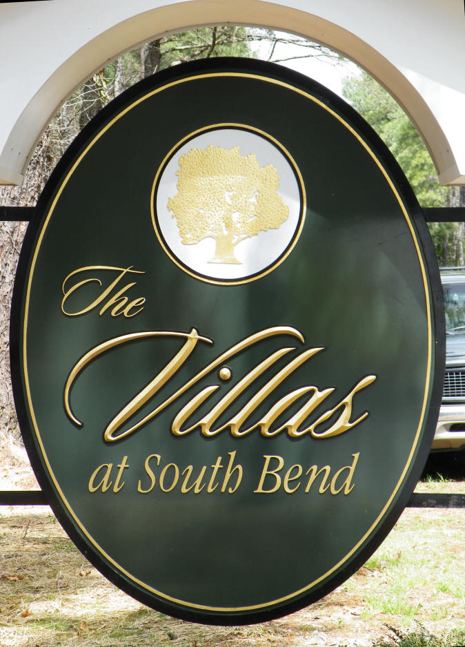 villas at vIr oval villas sign appliqued prismatic letters on hdu background with gold leaf from classic signs nc