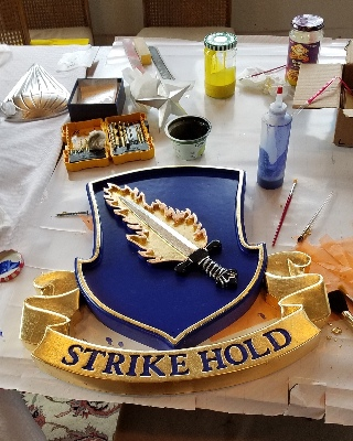 strike hold insignia hand carved for the 82nd command classic signs nc320x240