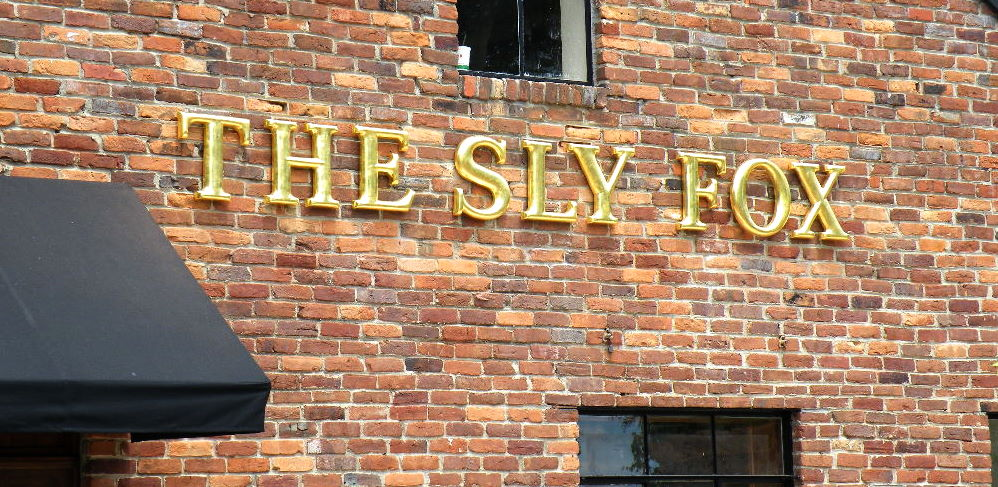 sly fox english pub formed letters with 23kt gold looks amazing at night classic signs nc 998x487