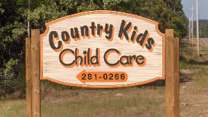 country kids daycare sandblasted hdu sign artificial woodgrain classic signs nc 300x169